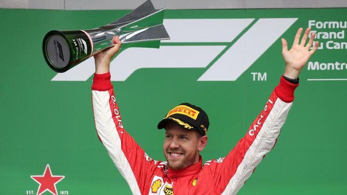 Sebastian Vettel tampil sebagai pemenang di GP Kanada 2018 (Foto: Carlo Allegri/Reuters)