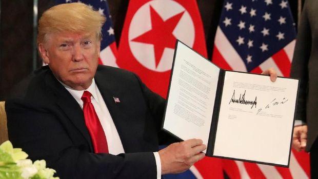Foto dokumen yang ditunjukkan Trump menunjukkan isi kesepakatan.