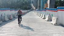 Naik Sepeda, Kakorlantas Buktikan Tanjakan Kali Kenteng Aman