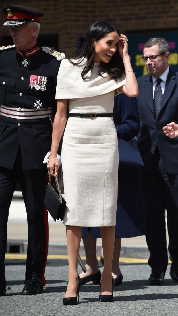 Meghan Markle saat menemani Ratu Elizabeth II melakukan kunjungan resmi.