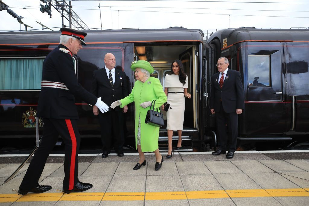 RUNCORN, CHESHIRE, ENGLAND - JUNE 14:  Queen Elizabeth II is greeted with Meghan, Duchess of Sussex as they arrive by Royal Train at Runcorn Station to open the new Mersey Gateway Bridge on June 14, 2018 in the town of Runcorn, Cheshire, England. Meghan Markle married Prince Harry last month to become The Duchess of Sussex and this is her first engagement with the Queen. During the visit the pair will open a road bridge in Widnes and visit The Storyhouse and Town Hall in Chester.  (Photo by Peter Byrne - WPA Pool/Getty Images)
