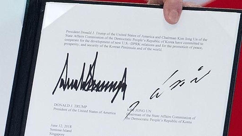 Mengungkap 4 Makna di Balik Tanda Tangan Kim Jong Un dan Donald Trump