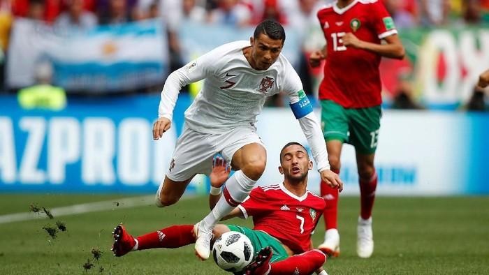 Aksi para pemain bintang di Piala Dunia 2018 seperti Cristiano Ronaldo sayang untuk dilewatkan (Foto: REUTERS/Axel Schmidt)