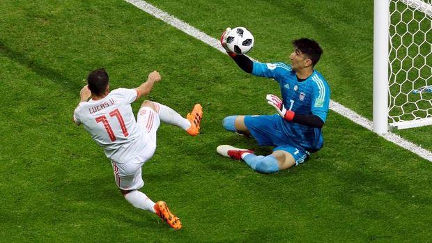 Spanyol harus bekerja keras untuk mengalahkan Iran dalam laga kedua di Grup B.