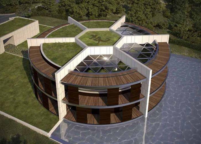Setengah dari atap rumah itu ditutupi dengan rumput hijau, beberapa sisi lainnya juga dilengkapi dengan kaca cermin yang memungkinkan cahaya matahari masuk ke bagian dalam. Istimewa/Inhabitat.