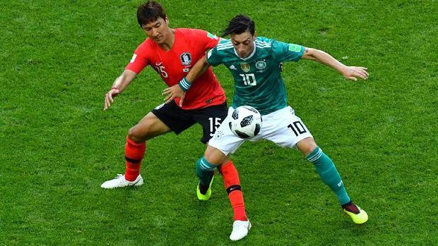 Mesut Oezil pensiun dari timnas Jerman usai Piala Dunia 2018.