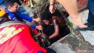Nyangkut di Saluran Air, Pria di Makassar Mandi Tanah