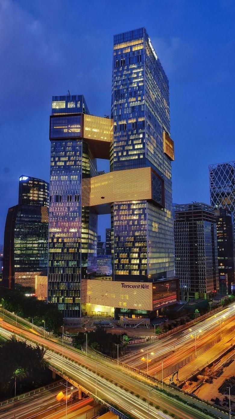 Kantor pusat Tencent di Shenzhen, China memiliki dua menara yang dapat menampung 11.000 karyawan. Pembangunan kantor ini diperkirakan menghabiskan USD 600 juta (8,5 triliun Rupiah). Foto: CNET