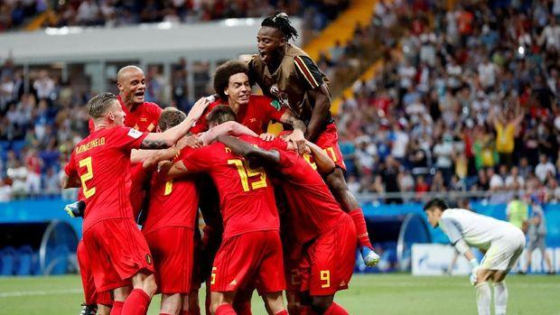Belgia melalui laga dramatis untuk meraih tiket perempat final.