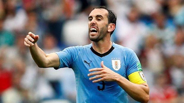 Diego Godin membela kesalahan Fernando Muslera saat Uruguay dikalahkan Prancis.
