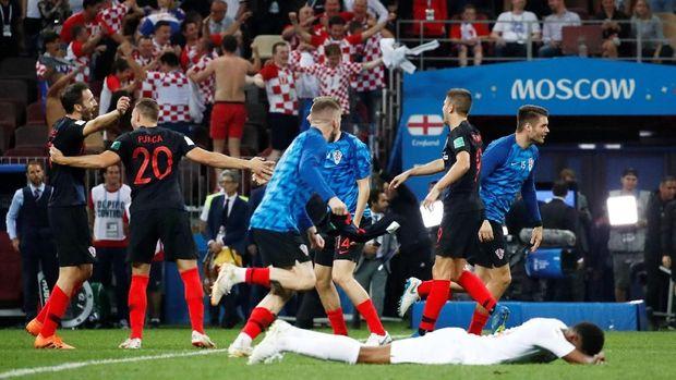 Marcus Rashford tergeletak di lapangan meratapi kekalahan timnya dari Kroasia.