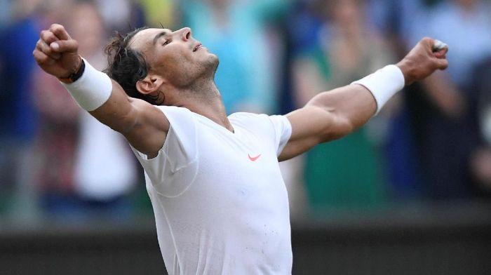 Meski tergusur ke peringkat 2 dunia, Rafael Nadal puas dengan musim 2018. (Foto: Tony OBrien/Reuters)