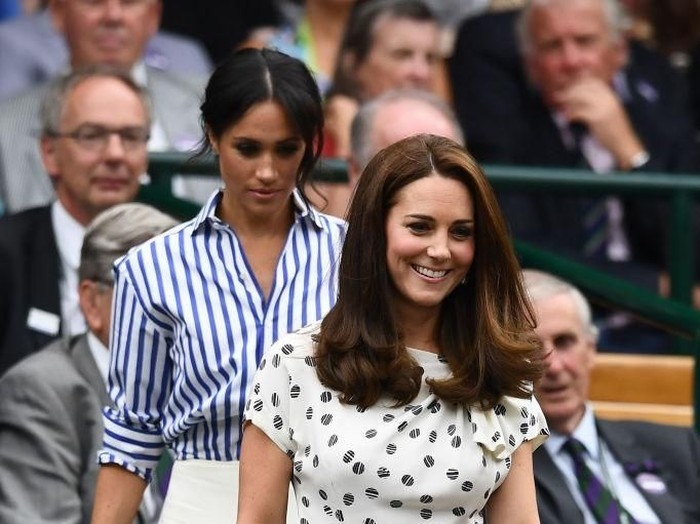 LONDON, ENGLAND - JULY 14: Meghan, Duchess of Sussex and Catherine, Duchess of Cambridge attend day twelve of the Wimbledon Lawn Tennis Championships at All England Lawn Tennis and Croquet Club on July 14, 2018 in London, England.  (Photo by Clive Mason/Getty Images)