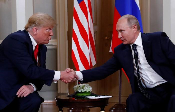 Ilustrasi Presiden Donald Trump dan Presiden Vladimir Putin (REUTERS/Kevin Lamarque)