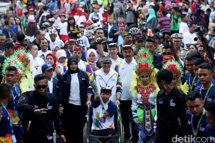 Kirab obor Asian Games 2018 saat ini tengah berada di Banyuwangi, Jawa Timur.