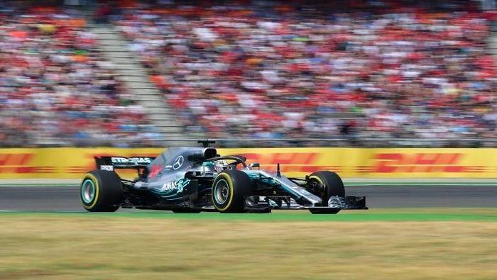 Lewis Hamilton memenangi GP Jerman 2018. (Foto: Andrej Isakovic/AFP Photo)