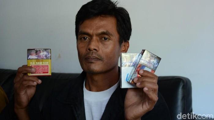 Gambar pria gendong bayi di bungkus rokok diambil dari Thailand. Foto: Istimewa