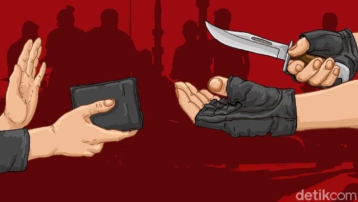 pejalan kaki diminta dompetnya dengan menodongkan pisau