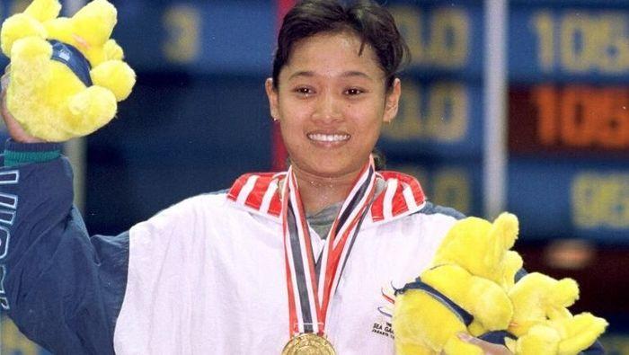 Winarni saat turun di Kejuaraan Dunia 1997 (Emmanuel Dunand/AFP)