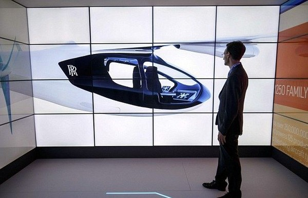 Taksi terbang ini bisa take off dan landing secara vertikal seperti helikopter. Taksi terbang akan menerapkan teknologi hybrid, perpaduan antara bahan bakar gas dan listrik. (AFP/Getty Images)