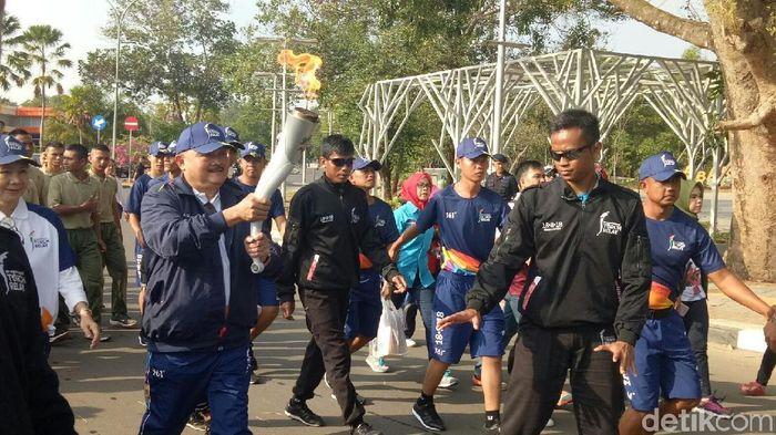 Kirab Obor Asian Games 2018 sudah sampai di Palembang (Raja Adil Siregar/detikSport)