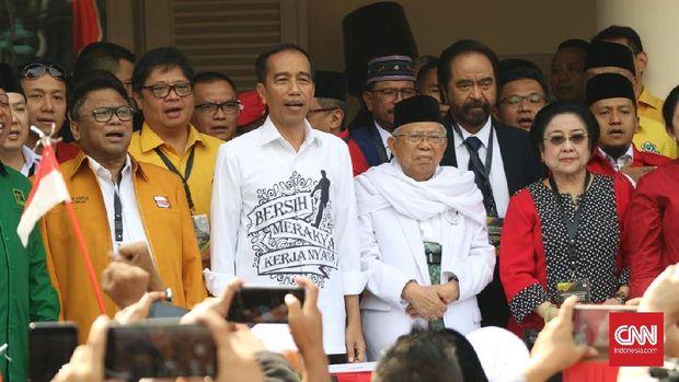 Jokowi Tampil dengan Kemeja Putih Berslogan