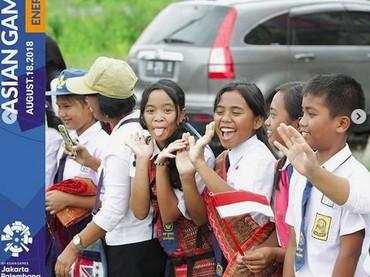 Anak-anak di daerah seperti di Sumatera Utara juga turut meramaikan pawai obor Asian Games 2018. (Foto: Instagram @asiangames2018).