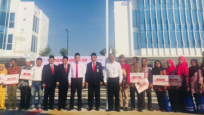 Perum Bulog Divre Kalsel bersama PT Timah Tbk melaksanakan Upacara Peringatan Hari Kemerdekaan RI ke-73.Foto: Rizki Ati Hulwa/detikcom