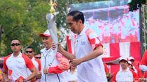 Detik-detik Api Obor Asian Games Mati di Tangan Jokowi