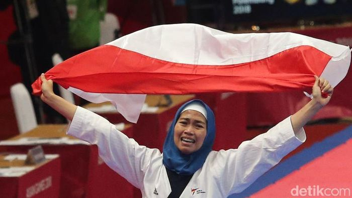 Defia Rosmaniar raih emas di cabor taekwondo Asian Games 2018 (Grandyos Zafna/detikSport)