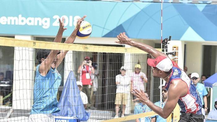 Voli pantai pria Indonesia beraksi di Asian Games 2018 (ANTARA FOTO/INASGOC/Muhammad Adimaja)