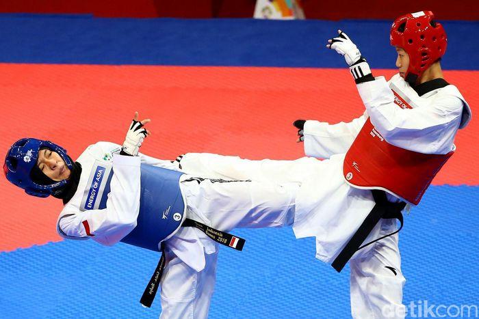 Atlet Indonesia Cinta Nadya Permata harus akui kemampuan atlet asal China Luo Zongshi usai dikalahkan dalam cabang taekwondo di kelas 57 kg putri.