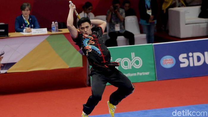 Achmad Hulaefi meraih medali perunggu Asian Games 2018 usai mengalahkan rasa sakit (Foto: Agung Pambudhy)