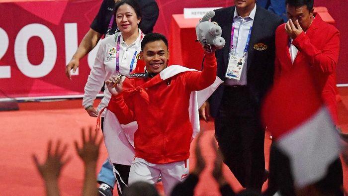 Eko Yuli memberi emas kelima untuk Indonesia di Asian Games 2018 (ANTARA FOTO/INASGOC/Fanny Octavianus)