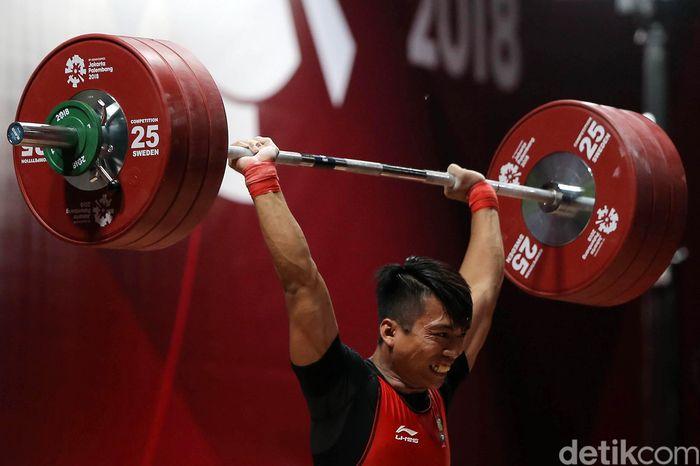 Lifter Indonesia Deni berhasil menjadi peringkat I grup B cabang angkat besi kelas 69 kg putra dengan total angkatan 318 kg.