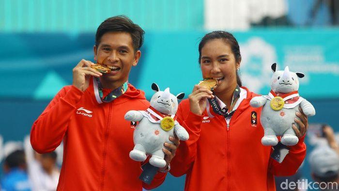 Christopher Rungkat/Aldila Sutjiadi meraih medali emas tenis Asian Games 2018 dari ganda campuran. (Rachman Haryanto/detikSport)