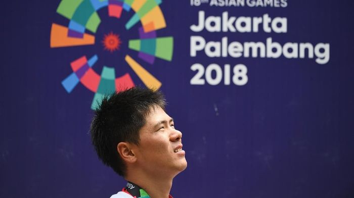 Yoshitaku Nagasako  terganggu dengan suara-suara di Wisma Atlet Kemayoran. (ANTARA FOTO/INASGOC/Mohammad Ayudha/Spt/18)
