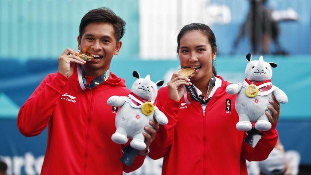 Christopher Rungkat/Aldila Sutjiadi mampu membuat kejutan dengan meraih emas nomor ganda campuran.