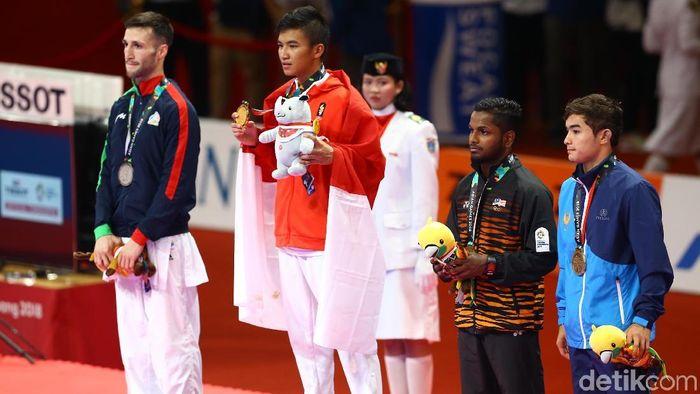 Rifki Ardiansyah Arrosyiid mempersembahkan emas untuk Indonesia dari cabang karate di Asian Games 2018 (Foto: Grandyos Zafna)