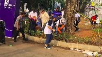 Sukseskan Maraton Asian Games, Menlu Pungut Sampah di GBK