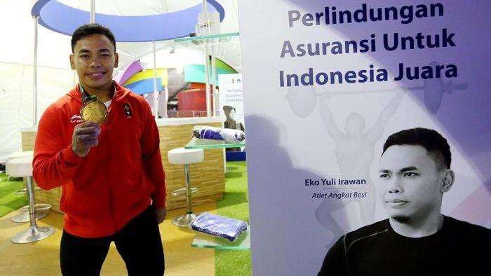Eko Yuli Irawan bakal ikut kejuaraan dunia angkat besi di China 20-25 Februari (dok. AXA Mandiri)