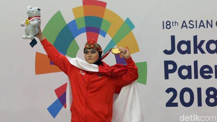 Puspa Arumsari mempersembahkan emas Asian Games 2018 buat instruktur yang sedang ultah (Foto: Agung Pambudhy)