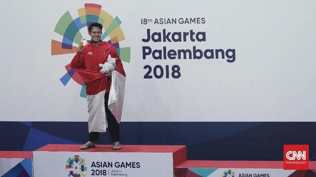 Komang Harik Adi Putra meraih medali emas pencak silat di Asian Games 2018.