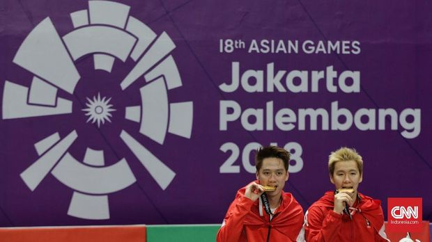 Kevin/Marcus usai meraih emas di Asian Games 2018.