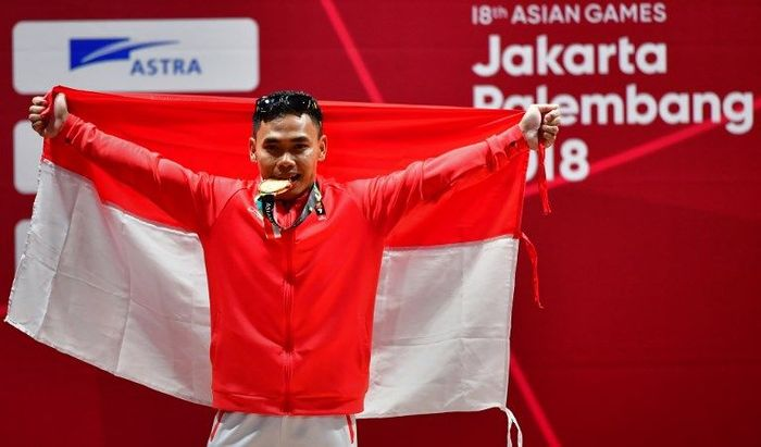 Eko Yuli Irawan membidik medali emas Olimpiade 2020. (Foto: Money Sharma/AFP Photo)