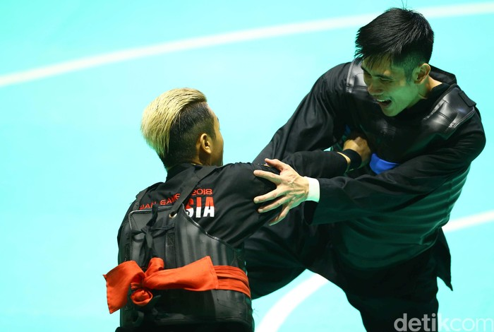Pencak Silat menambah lagi pundi-pundi medali Indonesia di Asian Games 2018. Kali ini atas nama Hanifan Yudani Kusumah. Foto: Grandyos Zafna/detikcom