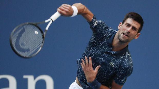 Novak Djokovic berhasil menang tiga set langsung untuk merebut tiket semifinal grand slam Amerika Serika Terbuka.
