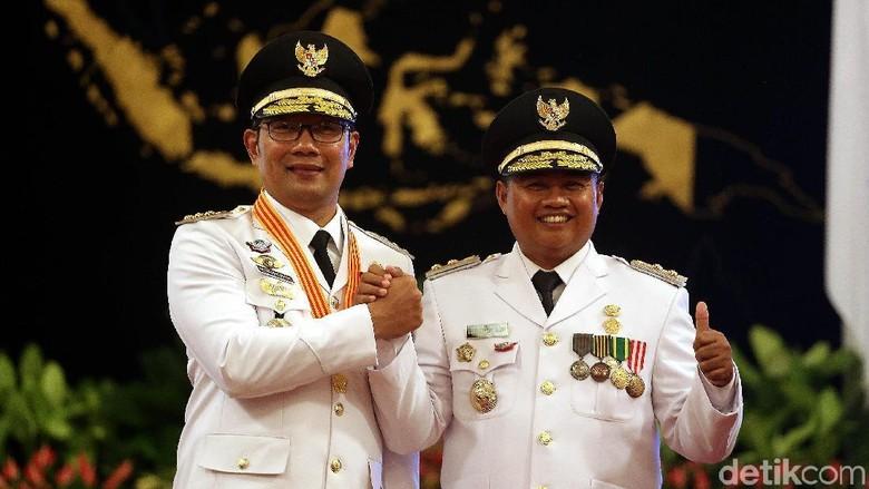 Gubernur Jawa Barat Ridwan Kamil dan wakilnya Uu Ruzhanul Ulum (Rengga Sancaya/detikFoto)