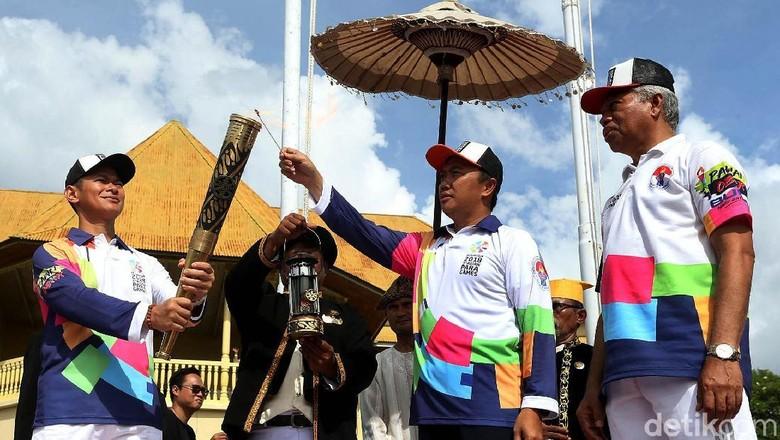 Api Obor Asian Para Games 2018 Diarak di Ternate/Foto: Rengga Sancaya