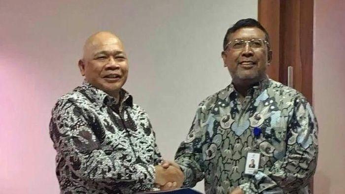 Jusman Syafii Djamal dan Deputi Kementerian BUMN Ahmad Bamban Foto: Dok. Istimewa